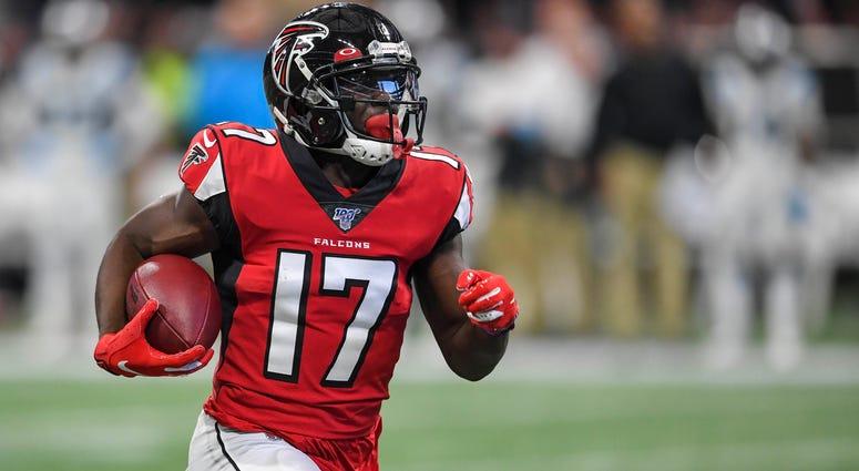 Atlanta Falcons wide receiver Olamide Zaccheaus (17) runs for a touchdown