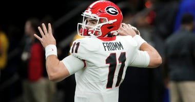 Jan 1, 2020; New Orleans, Louisiana, USA; Georgia Bulldogs quarterback Jake Fromm (11) throws in warm ups prior to kickoff against the Baylor Bears at the Mercedes-Benz Superdome. Mandatory Credit: Derick E. Hingle-USA TODAY Sports
