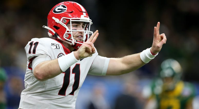 Jan 1, 2020; New Orleans, Louisiana, USA; Georgia Bulldogs quarterback Jake Fromm (11) gestures after a touchdown in the first half of the Sugar Bowl against the Baylor Bears at the Mercedes-Benz Superdome. Mandatory Credit: Chuck Cook-USA TODAY Sports