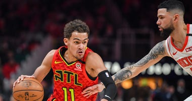 Jan 8, 2020; Atlanta, Georgia, USA; Atlanta Hawks guard Trae Young (11) dribbles defended by Houston Rockets guard Austin Rivers (25) during the second half at State Farm Arena. Mandatory Credit: Dale Zanine-USA TODAY Sports