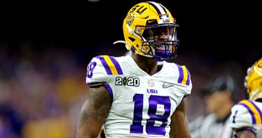 Jan 13, 2020; New Orleans, Louisiana, USA; LSU Tigers linebacker K'Lavon Chaisson (18) reacts during the first quarter against the Clemson Tigersin the College Football Playoff national championship game at Mercedes-Benz Superdome. Mandatory Credit: Chuck