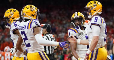 Jan 13, 2020; New Orleans, Louisiana, USA; LSU Tigers quarterback Joe Burrow (9) celebrates with wide receiver Justin Jefferson (2) after scoring a touchdown against the Clemson Tigers second quarter in the College Football Playoff national championship g