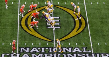 Jan 13, 2020; New Orleans, Louisiana, USA; LSU Tigers quarterback Joe Burrow (9) calls for the ball at midfield against Clemson Tigers in the College Football Playoff national championship game at Mercedes-Benz Superdome. Mandatory Credit: Stephen Lew-USA