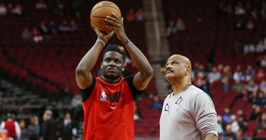Jan 31, 2020; Houston, Texas, USA; Houston Rockets center Clint Capela (left) practices as coach John Lucas (right) looks on before a game against the Dallas Mavericks at Toyota Center. Mandatory Credit: Troy Taormina-USA TODAY Sports