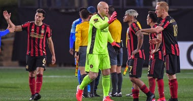 Feb 25, 2020; Kennesaw, Georgia, USA; Atlanta United goalkeeper Brad Guzan (1) (yellow jersey) reacts with his teammates after they defeated FC Motagua 3-0 at Fifth Third Bank Stadium. Mandatory Credit: Dale Zanine-USA TODAY Sports
