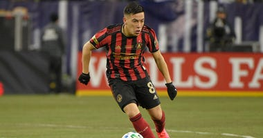 Feb 29, 2020; Nashville, TN, USA; Atlanta United midfielder Ezequiel Barco (8) dribbles the ball against the Nashville SC during the second half at Nissan Stadium Mandatory Credit: Steve Roberts-USA TODAY Sports