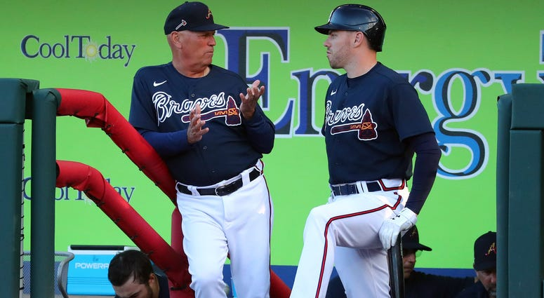 Mar 9, 2020; North Port, Florida, USA;Atlanta Braves manager Brian Snitker (43) talks with first baseman Freddie Freeman (5) during the third inning against the Boston Red Sox at CoolToday Park. Mandatory Credit: Kim Klement-USA TODAY Sports