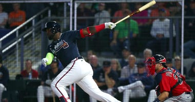 Mar 9, 2020; North Port, Florida, USA; Atlanta Braves left fielder Marcell Ozuna (20) singles during the sixth inning against the Boston Red Sox at CoolToday Park. Mandatory Credit: Kim Klement-USA TODAY Sports