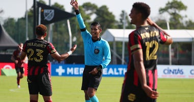 Atlanta United FC midfielder Jake Mulraney (23) gets his second yellow card and a red card