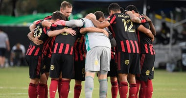 Jul 21, 2020; Kissimmee, FL, USA; Atlanta United starting line up huddle up the field prior to the game against the Columbus Crew at ESPN Wide World of Sports. Mandatory Credit: Douglas DeFelice-USA TODAY Sports