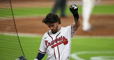 Jul 29, 2020; Atlanta, Georgia, USA; Atlanta Braves shortstop Dansby Swanson (7) shows emotion after scoring against the Tampa Bay Rays in the sixth inning at Truist Park. Mandatory Credit: Brett Davis-USA TODAY Sports