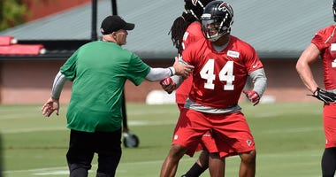 Aug 1, 2015; Atlanta, GA, USA; Atlanta Falcons head coach Dan Quinn works with defensive end Vic Beasley (44) on the field during training camp at the Flowery Branch Training Facility. Mandatory Credit: Dale Zanine-USA TODAY Sports