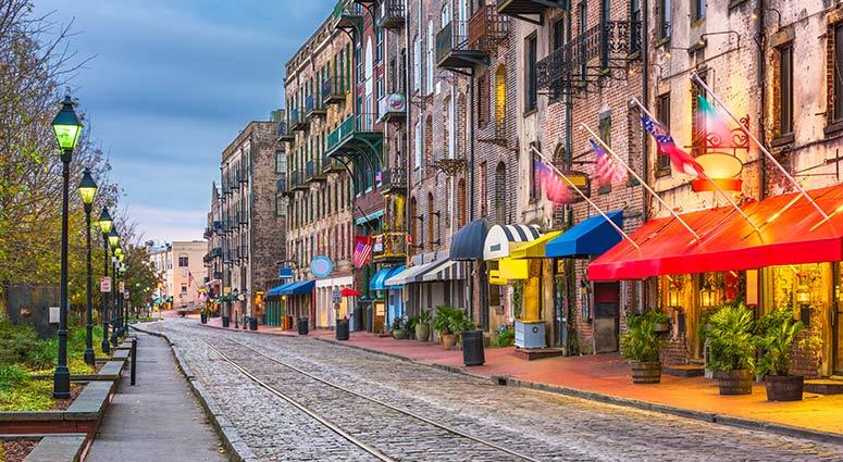 Savannah, Georgia, USA bars and restaurants on River Street at twilight