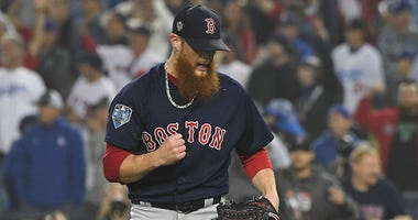 pitcher Craig Kimbrel celebrates after defeating the Los Angeles Dodgers in game four of the 2018 World Series