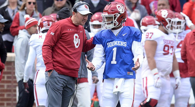 Oklahoma Sooners head coach Lincoln Riley speaks to quarterback Kyler Murray