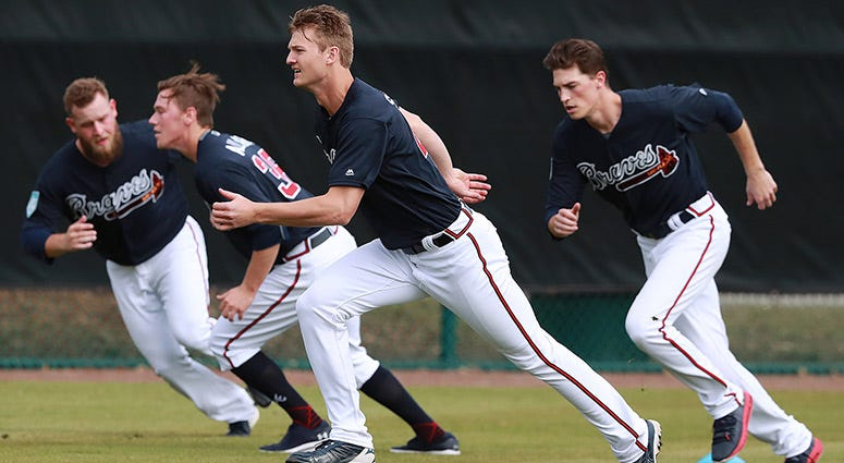 Atlanta Braves pitchers, from left, A. J Minter, Kolby Allard, Mike Soroka, and Max Fried run sprints