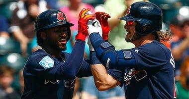 Atlanta Braves third baseman Josh Donaldson (20) celebrates with Atlanta Braves second baseman Ozzie Albies