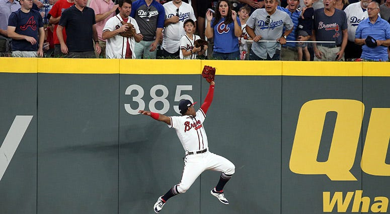 Atlanta Braves left fielder Ronald Acuna Jr. makes a catch at the wall