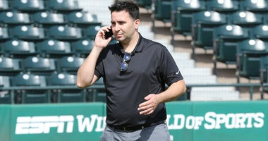 Atlanta Braves general manager Alex Anthopoulos works the phone minutes before announcing the team signed veteran catcher Chris Stewart to a one-year major league contract, a non-guaranteed deal that provides the team with more depth at a key position in
