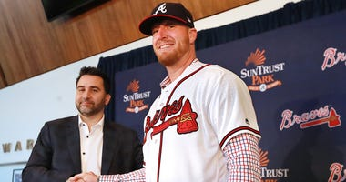Atlanta Braves Executive Vice President and General Manager Alex Anthopoulos introduces left-handed pitcher Will Smith, who just signed a three-year, $39 million contract with a one-year club option, during a press conference at SunTrust Park on Tuesday,