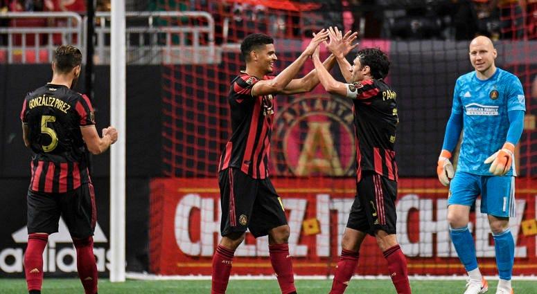Atlanta United Defenders Leando Gonzalez Pirez, Miles Robinson, and Michael Parkhurst, and Goalie Brad Guzan