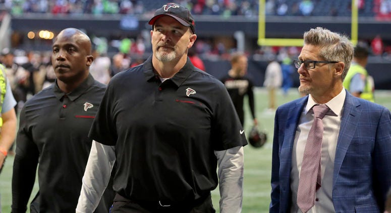 Oct 27, 2019; Atlanta, GA, USA; Atlanta Falcons head coach Dan Quinn (middle) leaves the field with general manager Thomas Dimitroff (right) after a loss to the Seattle Seahawks at Mercedes-Benz Stadium. Mandatory Credit: Jason Getz-USA TODAY Sports
