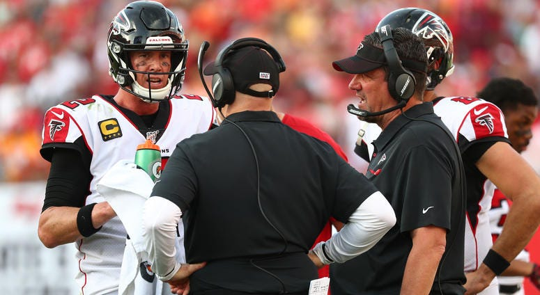 Dec 29, 2019; Tampa, Florida, USA;Atlanta Falcons quarterback Matt Ryan (2) talks with head coach Dan Quinn and quarterback coach Greg Knapp during the second half against the Tampa Bay Buccaneers at Raymond James Stadium. Mandatory Credit: Kim Klement-US