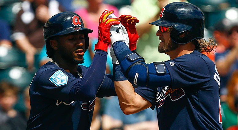 Atlanta Braves third baseman Josh Donaldson (20) celebrates with Atlanta Braves second baseman Ozzie Albies