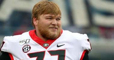 Nov 2, 2019; Jacksonville, FL, USA;Georgia Bulldogs offensive tackle Cade Mays (77) works out prior to the game at TIAA Bank Field. Mandatory Credit: Kim Klement-USA TODAY Sports