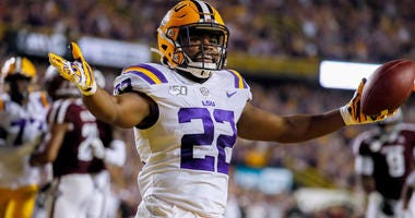 Nov 30, 2019; Baton Rouge, LA, USA; LSU Tigers running back Clyde Edwards-Helaire (22) reacts after scoring on a five yard touchdown against the Texas A&M Aggies during the first quarter at Tiger Stadium. Mandatory Credit: Stephen Lew-USA TODAY Sports