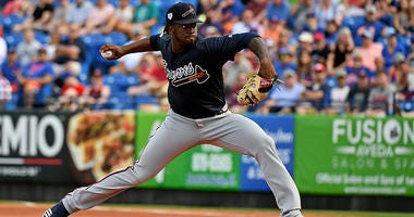 Atlanta Braves starting pitcher Touki Toussaint (62) delivers a pitch