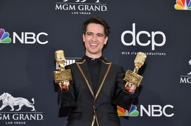 """Brendon Urie of Panic! at the Disco poses with the award for Top Rock Song for """"High Hopes"""" in the press room during the 2019 Billboard Music Awards at MGM Grand Garden Arena on May 01, 2019 in Las Vegas, Nevada"""